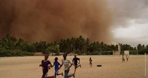children running with a sandstorm beginning